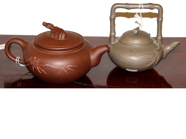 Two Yixing style teapots, each one with a cover,