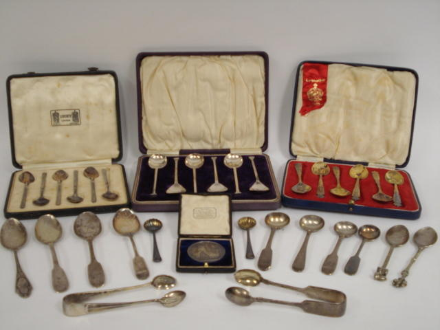 A silver set of arts and crafts coffee spoons by Liberty & co, Birmingham 1913