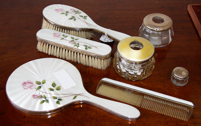 A silver and enamel mounted dressing table set DCB's, London, 1961