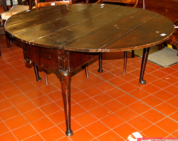 A mid-18th Century oak drop-leaf dining table,