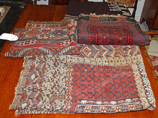A Yomut Ensi fragment,a Soumak mat; a Belouch storage bag with piled face; and a dark brown flatweave throw with ivory coloured border decoration,(4)