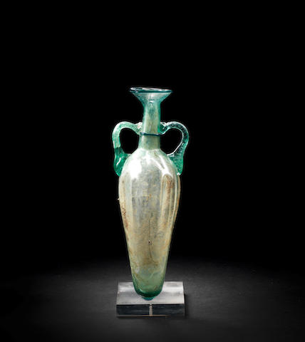 A Roman pale green glass amphora