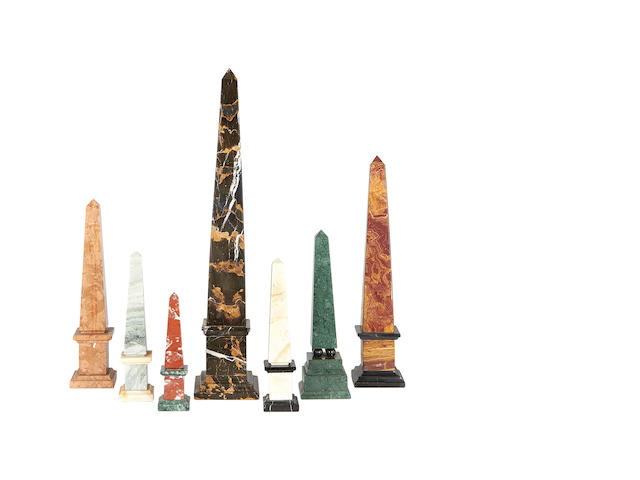 A collection of seven marble obelisks