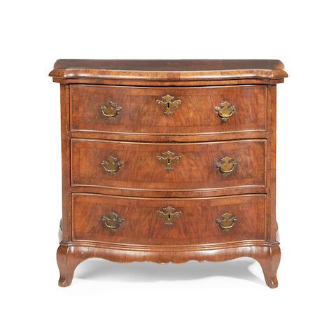 An Italian walnut crossbanded miniature serpentine chest