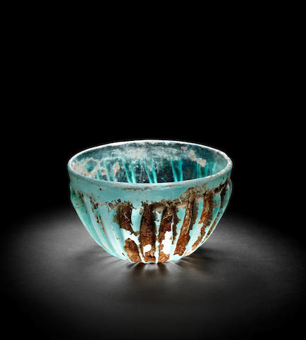 A Roman cast blue-green glass bowl