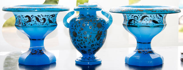A suite of three blue opaline vases