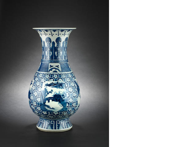 A blue and white, pear-shaped vase
