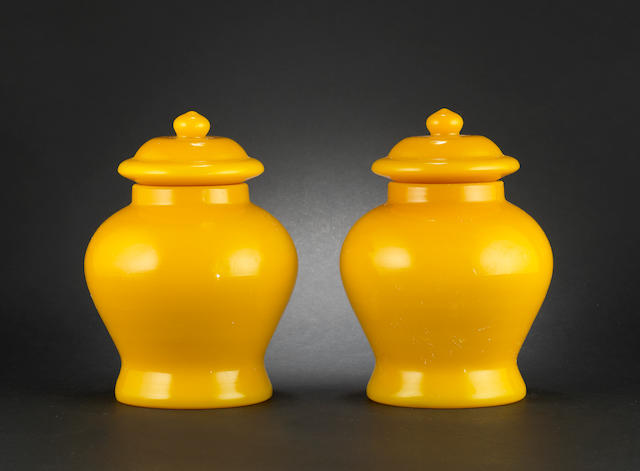 A pair of Beijing glass-style, vases and covers Qianlong incised four-character marks