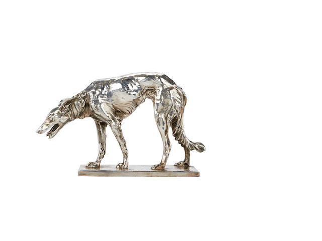 An early 20th century silvered metal model of an Irish Wolfhound signed Jos. Körsdejgen