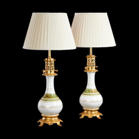 A pair of gilt metal and coloured glass moderator lamps adapted for electricityin the Chinese taste