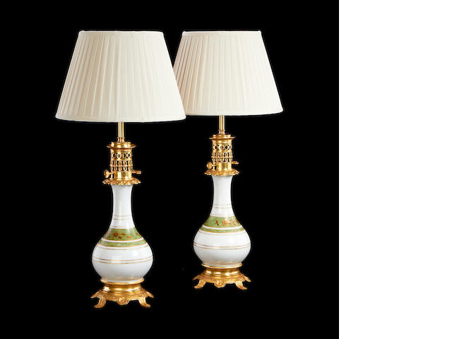 A pair of gilt metal and coloured glass moderator lamps adapted for electricity in the Chinese taste