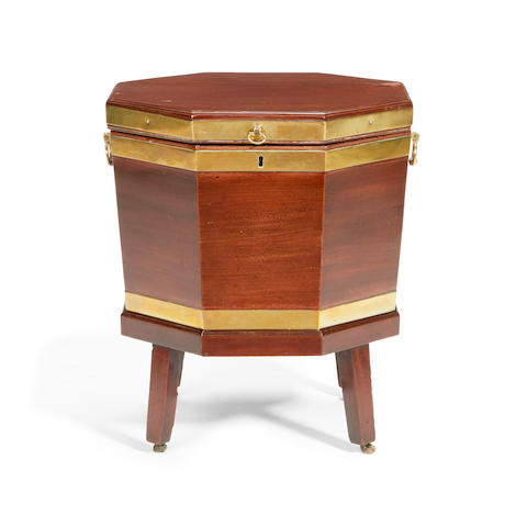 A George III mahogany and brass bound octagonal cellaret
