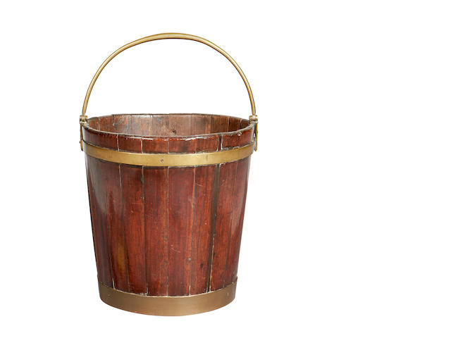 A George III mahogany and brass bound peat bucket