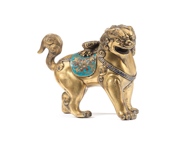 A rare gilt-bronze and cloisonné enamel standing Buddhist lion 18th/19th century