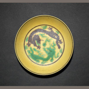 A green and yellow dragon saucer