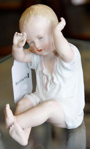 A Gebruder Heubach bisque piano baby,