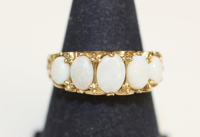 A 9ct gold opal five stone ring,