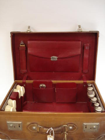 An Edwardian gentleman's leather suitcase with fitted interior Birmingham 1907-8