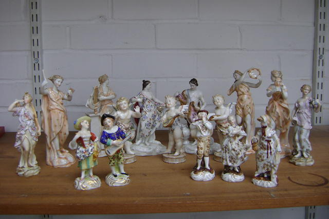 A set of four Volkstedt figures