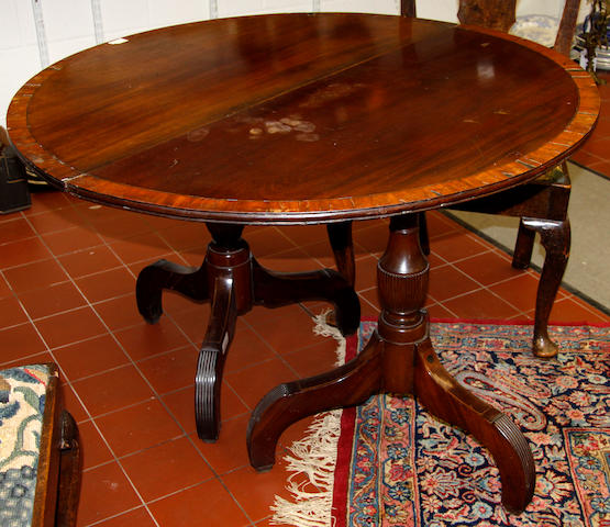 A pair of mahogany demi-lune tables 19th Century