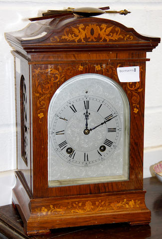 An Edwardian rosewood mantel clock