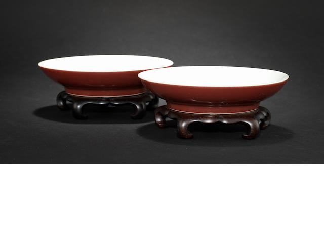 A pair of sang-de-boeuf monochrome, saucer dishes Qianlong six-character marks