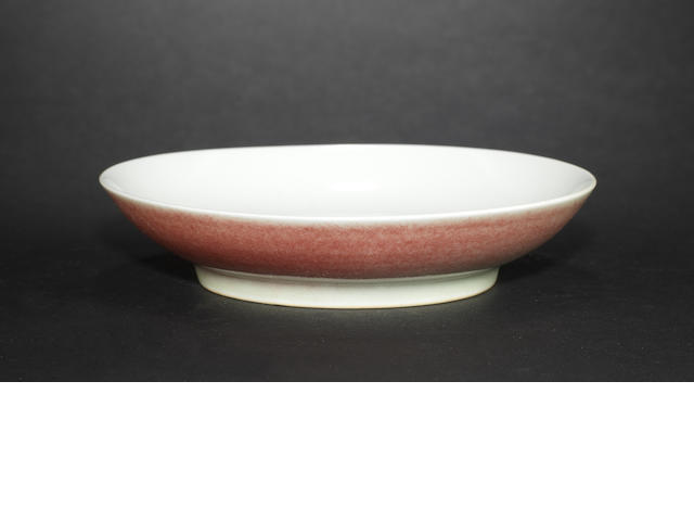 A mottled peachbloom saucer dish Qianlong six-character mark