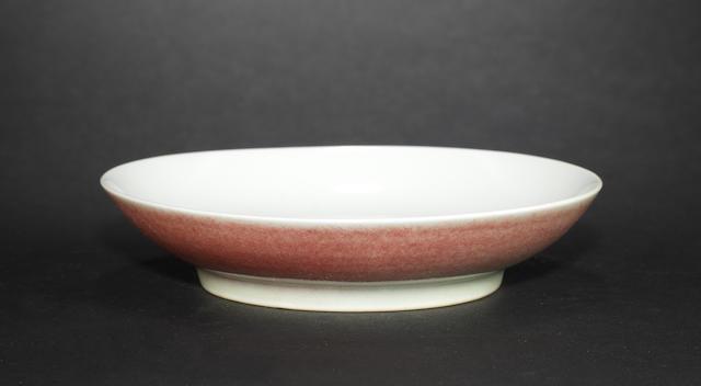 A mottled peachbloom saucer dish Qianlong six-character mark