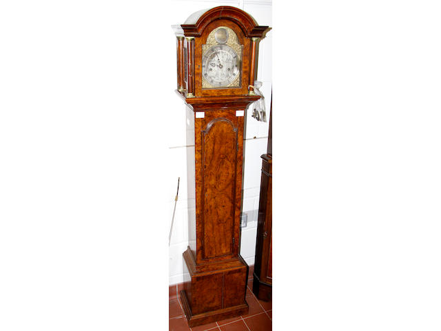 A walnut grandmother longcase clock,in 18th Century taste with arched hood and part sivlred dial inscribed Samuel Lea, London, 166cm high