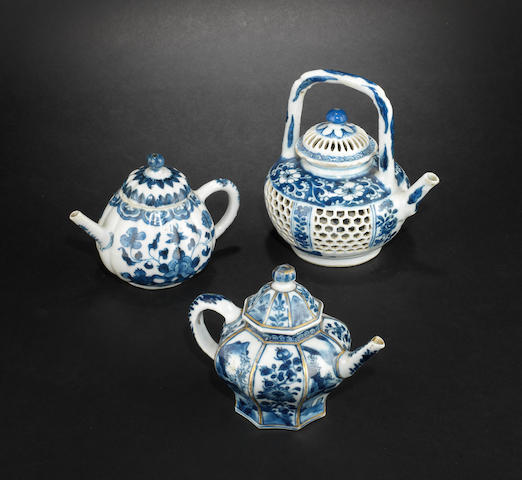 Three blue and white teapots with covers