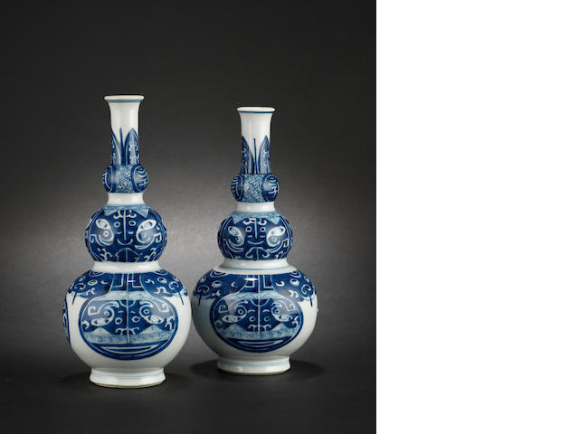 An associated pair of blue and white triple gourd vases Kangxi