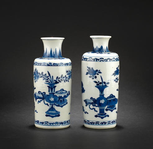 An associated pair of blue and white rouleau vases Qing Dynasty
