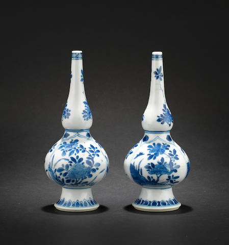 A pair of blue and white rosewater sprinklers Kangxi