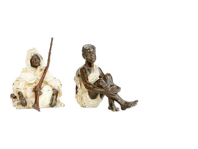 Two late 19th century Viennese cold painted bronze Nubian figures in the style of Franz Bergman, Austrian (1961-1936)