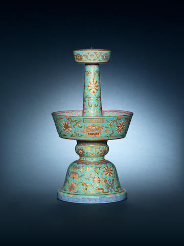 A famille rose turquoise-ground candlestick Daoguang, four-character mark Jing jin tang zhi (Hall of Skilfully Acquired Progress)