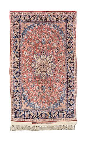An Isfahan rug, Central Persia, 174cm x 104cm, signed Serafian
