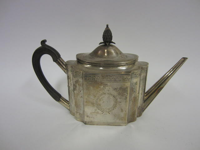 An Edwardian silver bright cut Neo-Classical style tea pot by Charles Stuart Harris, London 1909