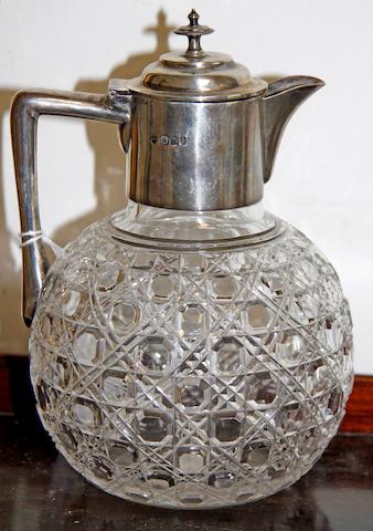 A silver handled cut glass claret jug
