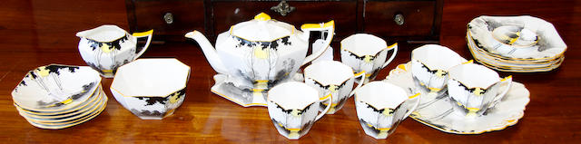A Shelley china tall trees and sunrise pattern tea set,comprising teapot and stand, six cups and saucers, six side plates, sugar bowl, milk jug, spoon rest and a sandwich plate.