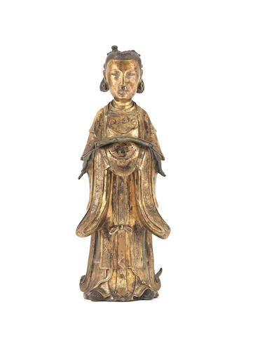 A rare and large gilt-bronze figure of a lady 16th/17th century