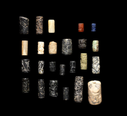 A group of twenty-two Mesopotamian cylinder seals and two other cylinder seals, 24