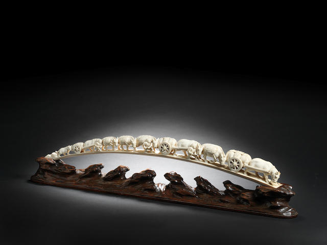 An ivory tusk carving of a rural procession Meiji Period