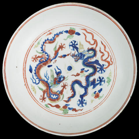 A very rare large wucai 'dragon' saucer dish Longqing six-character mark and of the period