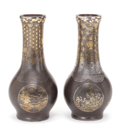 A pair of inlaid iron vases By the Komai Company of Kyoto, Meiji Period