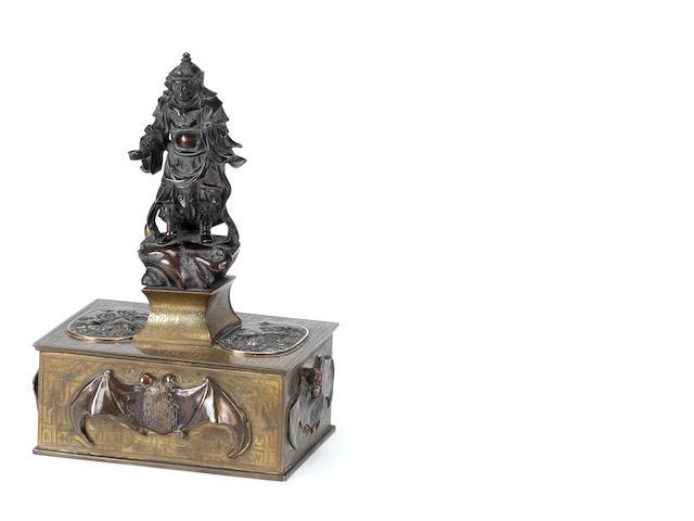 A bronze single-hole table-top cigar-cutter By Sadanori, Meiji Period