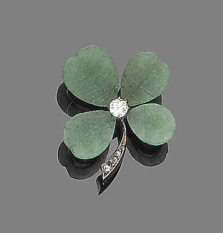 An aventurine quartz and diamond brooch,