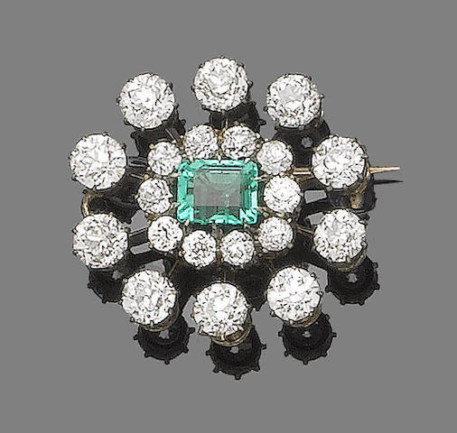 An emerald and diamond target brooch,