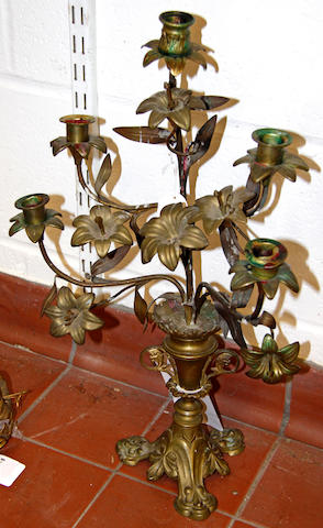 A Continental brass candelabra with floral branches,