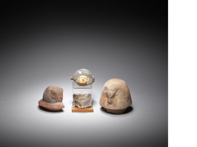 Four Egyptian terracotta canopic jar lids 4