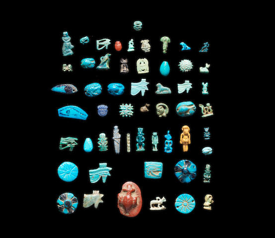 A group of Egyptian glass and glazed composition amulets and beads a lot